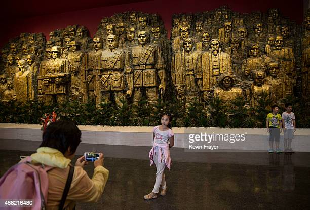 Chinese girls poses for a picture during a visit to the Museum of the War of Chinese People's Resistance Against Japanese Aggression on September 1...