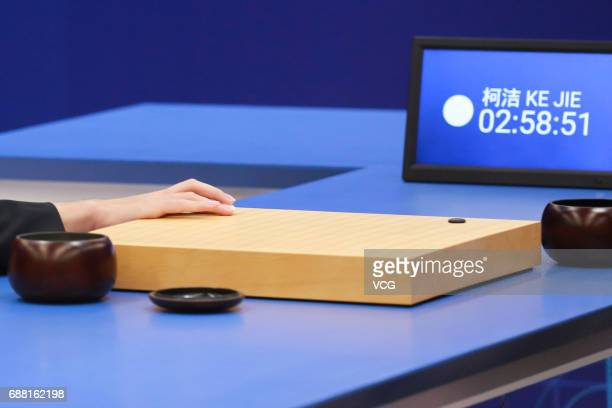 Chinese Go player Ke Jie competes against Google's artificial intelligence programme AlphaGo during the their second match on day two of Future of Go...