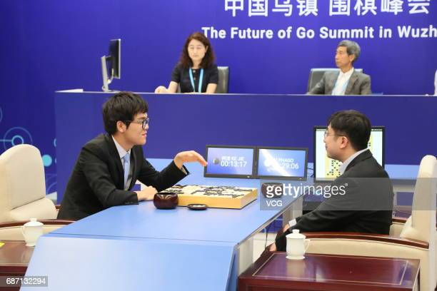 Chinese Go player Ke Jie reacts during the first match against Google's artificial intelligence programme AlphaGo on day one of Future of Go Summit...