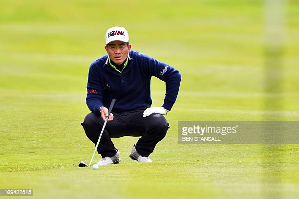 Chinese golfer WenChong Liang linesup a shot onto the 15th green during the second round of the PGA Championship at Wentworth Golf Club in Surrey...