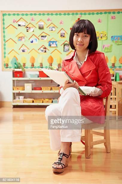 Chinese grade school teacher in classroom
