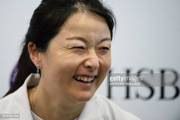 Chinese grand slam champion doubles tennis player Yan Zi laughs during an event to launch grassroots tennis programme 'The Road to Wimbledon' in Hong...