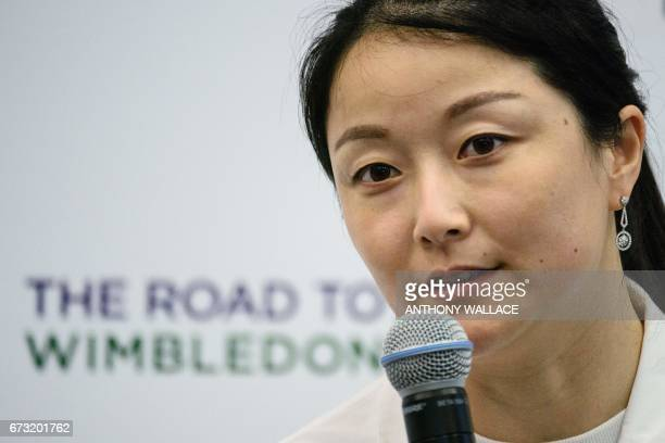 Chinese grand slam champion doubles tennis player Yan Zi speaks during an event to launch grassroots tennis programme 'The Road to Wimbledon' in Hong...