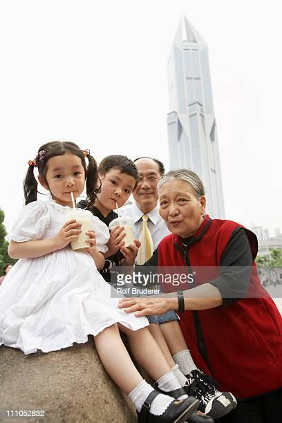 Chinese grandparents enjoying grandchildren