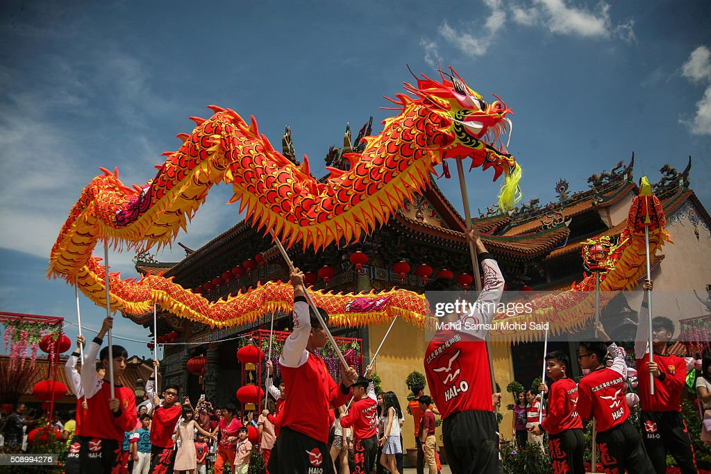 A Chinese group perform a Dragon dance inside the Guan Yin temple as they offer a prayer during Lunar New Year of the monkey celebrations on February 8, 2016 outside Kuala Lumpur, Malaysia. According to the Chinese Calendar, the Lunar New Year which falls on February 8 this year marks the Year of the Monkey, the Chinese Lunar New Year also known as the Spring Festival is celebrated from the first day of the first month of the lunar year and ends with Lantern Festival on the Fifteenth day.