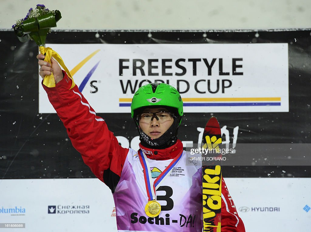 Chinese Guangpu Qi celebrates on podium after winning after the Men's FreeStyle Aerials final race at the Snowboarding and Free Style World Cup Test Event at the Snowboard and Free Style Centre in Rosa Khutor near the Russian Black Sea resort of Sochi on February 17, 2013.Chinese Guangpu Qi won the race ahead of Chinese Zhongqing Liu and Belorussian Denis Osipau.