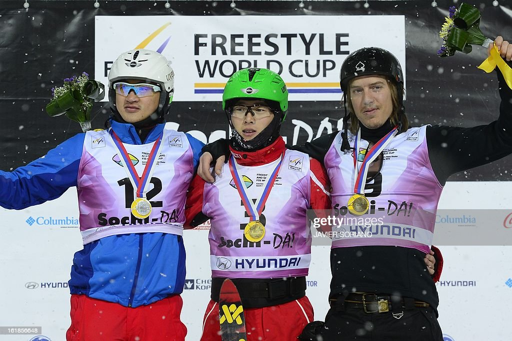 Chinese Guangpu Qi (C), Chinese Zhongqing Liu (L) and Belarus Denis Osipau pose on podium after the Men's FreeStyle Aerials final race at the Snowboarding and Free Style World Cup Test Event at the Snowboard and Free Style Centre in Rosa Khutor near the Russian Black Sea resort of Sochi on February 17, 2013.Chinese Guangpu Qi won the race ahead of Chinese Zhongqing Liu and Belorussian Denis Osipau.