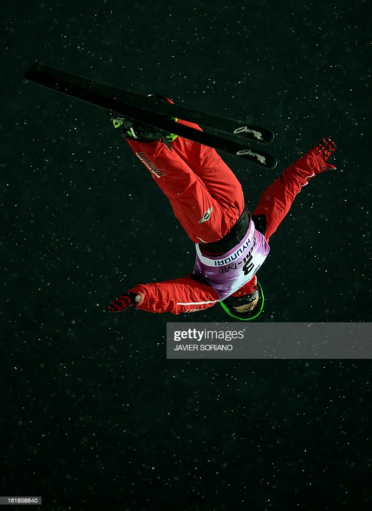 Chinese Guangpu Qi competes during the Men's FreeStyle Aerials final race at the Snowboarding and Free Style World Cup Test Event at the Snowboard and Free Style Centre in Rosa Khutor near the Russian Black Sea resort of Sochi on February 17, 2013.Chinese Guangpu Qi won the race ahead of Chinese Zhongqing Liu and Belorussian Denis Osipau.