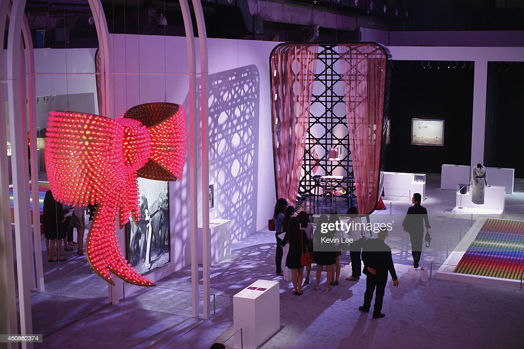 Chinese guests look at an exhibit at the Miss Dior Exhibition on June 19, 2014 in Shanghai, China.