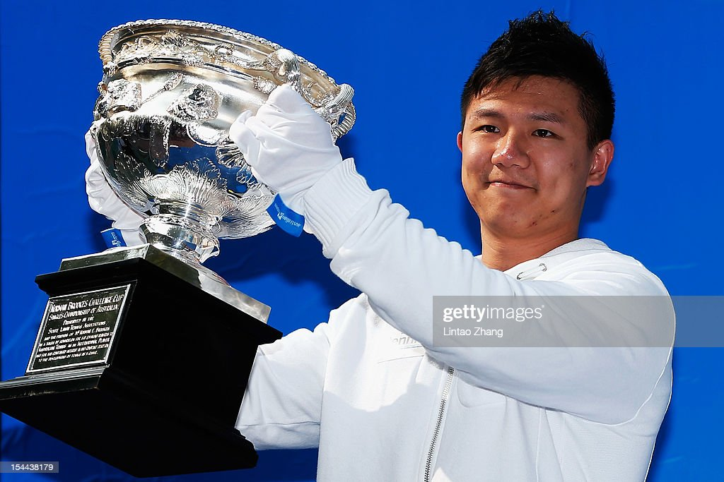 Chinese Gymnastics champion Chen Yibng holds the Norman Brookes Challenge Cup during the Australian Open Trophies Tour at The Beijing University on October 20, 2012 in Beijing, China.
