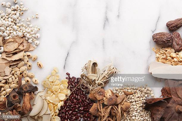 Chinese Herbal Medicine Remedy Ingredients on Marble with Copy Space