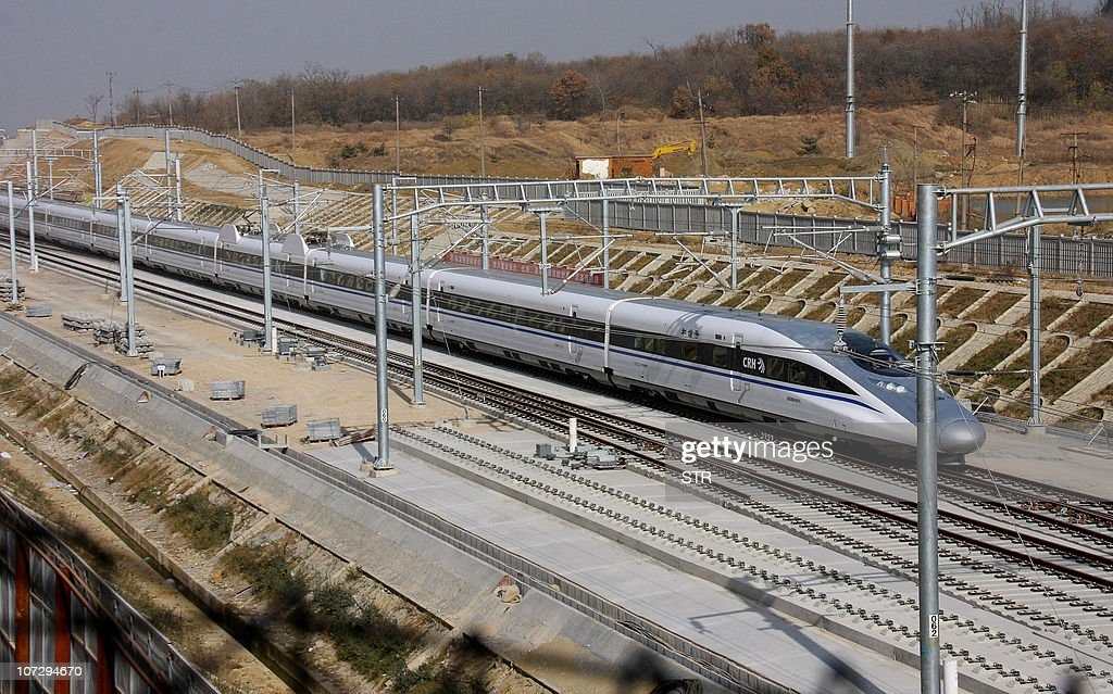 A Chinese hi-speed train achieves a record for unmodified conventional commercial trains, on a stretch of track between the capital Beijing and Shanghai, in Bengbu, east China's Anhui province on December 2, 2010. China's railways ministry said that one of its passenger trains had broken a world speed record, travelling at 486.1 kilometres per hour (301 mph) in a test run, state media reported. CHINA