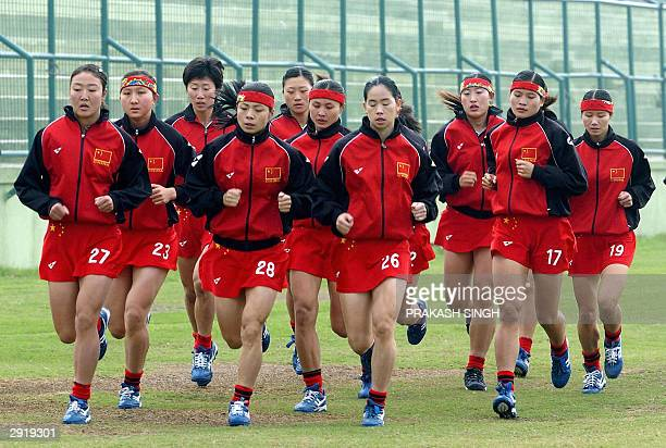 Chinese hockey players warm up prior to a league match against Kazakhstan at the 5th Women's Asia Hockey Cup in New Delhi 01 February 2004 Eight...