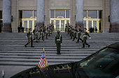 A Chinese honour guard remains at attention as the US flag flies on US President George W Bush's limousine following his arrival at Great Hall of the...
