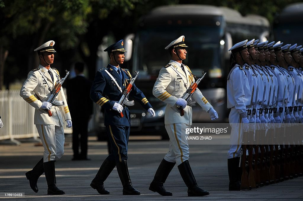 Chinese honour guards prepare for the arrival of Kenya's President Uhuru Kenyatta and Chinese President Xi Jinping during a welcoming ceremony outside the Great Hall of the People in Beijing on August 19, 2013. Uhuru Kenyatta is on a visit to China from August 18 to 23.