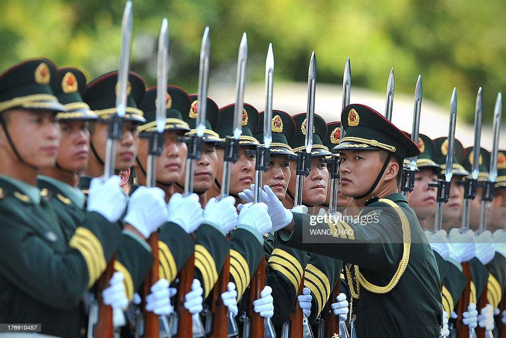 Chinese honour guards prepare for the arrival of Kenya's President Uhuru Kenyatta and Chinese President Xi Jinping during a welcoming ceremony outside the Great Hall of the People in Beijing on August 19, 2013. Uhuru Kenyatta is on a visit to China from August 18 to 23. AFP PHOTO / WANG ZHAO