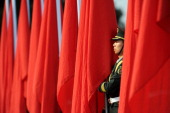 Chinese honour guards prepare for the arrival of Kuwaiti Prime Minister Jaber Mubarak Hamad Sabah and Chinese Premier Li Keqiang during a welcome...