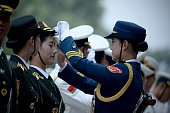 Chinese honour guards prepare for the arrival of New Zealand's GovernorGeneral Jerry Mateparae and Chinese President Xi Jinping during a welcome...