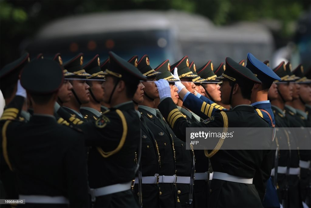 Chinese honour guards prepare for the arrival of Sri Lankan President Mahinda Rajapaksa outside the Great Hall of the People in Beijing on May 28,2013. Mahinda Rajapaksa is on a two-day visit to China. AFP PHOTO/WANG ZHAO