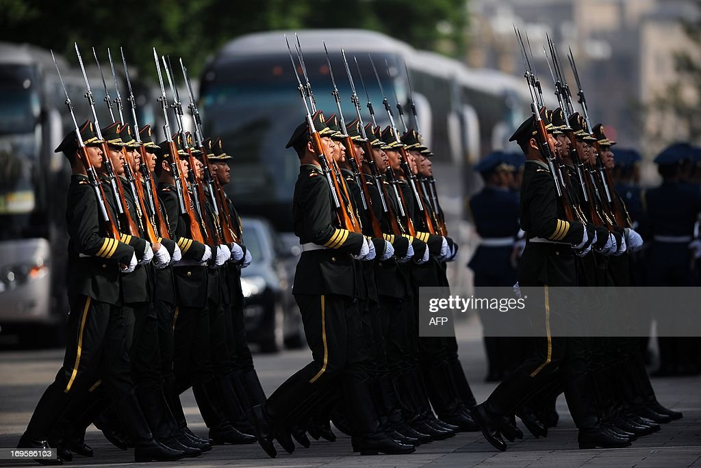 Chinese honour guards prepare for the arrival of Sri Lankan President Mahinda Rajapaksa outside the Great Hall of the People in Beijing on May 28,2013. Mahinda Rajapaksa is on a two-day visit to China.