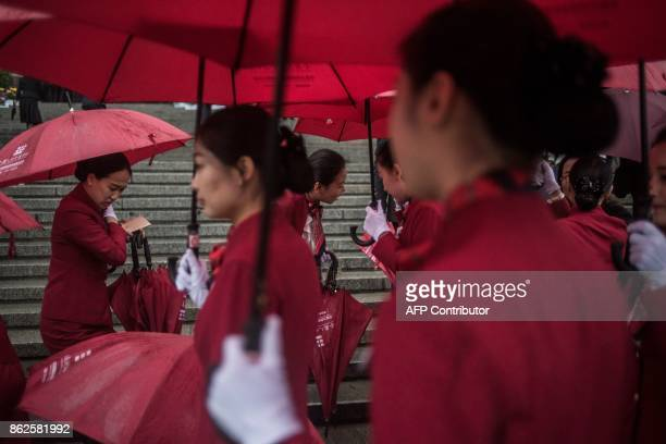 TOPSHOT Chinese hostesses arrive at the start of the Communist Party's 19th Congress in Beijing on October 18 2017 The Chinese Communist Party opens...