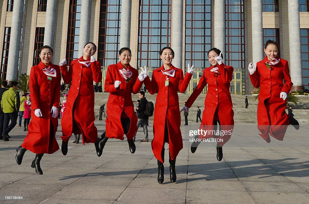 Chinese hostesses during the opening session of the Chinese Communist Party's fiveyearly Congress at the Great Hall of the People in Beijing on...