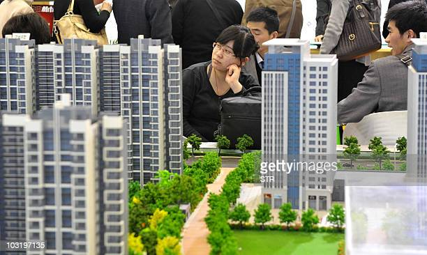 Chinese house shoppers gather at a property fair in Beijing on August 2 2010 China's banking regulators will step up spot checks on banks in the...