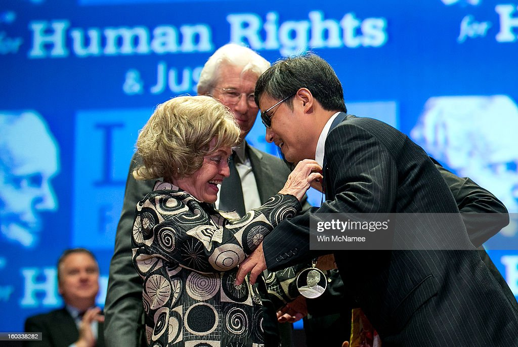 Chinese human rights activist Chen Guangcheng (R) is awarded the 2012 Tom Lantos Human Rights Prize by Lantos' widow Annette Lantos (L) as actor Richard Gere watches January 29, 2013 in Washington, DC. The Lantos Human Rights Prize is awarded each year and aims to raise awareness regarding human rights violations and the individuals dedicated to fighting them around the world.