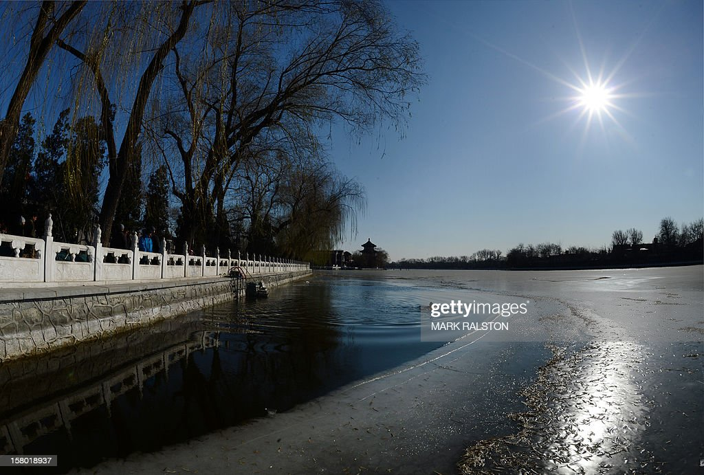 A Chinese ice swimmer takes his daily swim in the frozen Houhai Lake in Beijing on December 9, 2012. Winter swimming is especially popular amongst the elderly and retired as it is believed to improve circulation and benefit health, and also said to increase the level of mental awareness, release stress, remove aches and pains, increase vitality and keep skin looking younger - and of course, an overall feeling of well-being. AFP PHOTO/Mark RALSTON