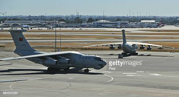 Chinese Ilyushin IL76s aircraft taxis past a sister plane at Perth International Airport after returning from the ongoing search operations for...