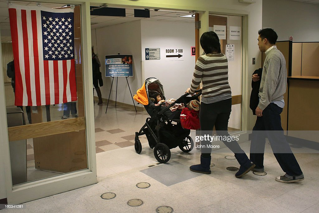 Chinese immigrants leave with their baby after an interview at the U.S. Citizenship and Immigration Services (USCIS), district office on January 29, 2013 in New York City. Some 118,000 immigrants applied for U.S. citizenship and 2,500 children received citizenship certificates in the New York City dictrict in 2012. Although underage children of naturalized immigrants usually receive U.S. citizenship, they must go through a process at the USCIS in order to receive legal certificates. Children born in the United States are American, regardless of the immigrant status of their parents.