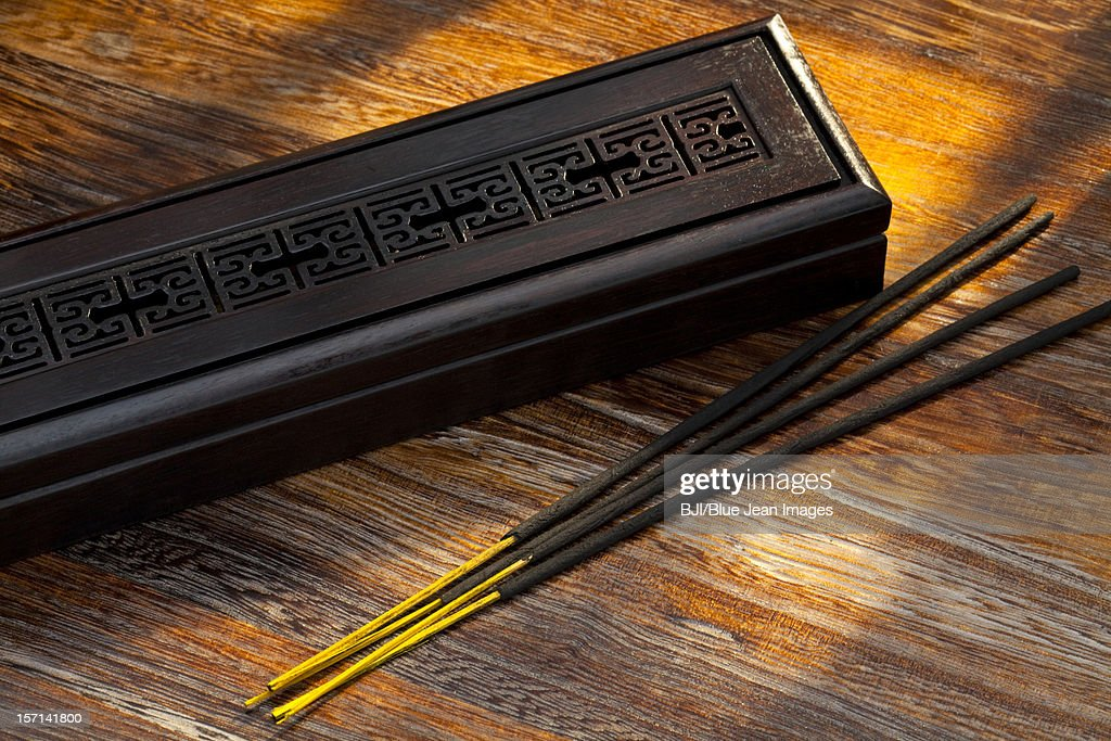 Chinese incense on table : Stock Photo