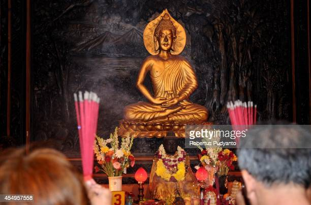Chinese Indonesians pray to celebrate MidAutumn Festival at Sanggar Agung Temple on September 8 2014 in Surabaya Indonesia The MidAutumn festival is...