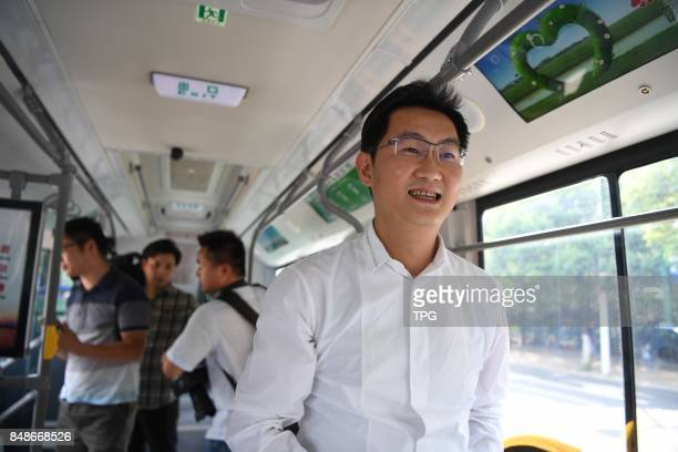 Chinese IT Giant Tencent's Chairman and CEO Pony Ma demonstrates taking bus by sweeping QR code in Hefei CityAnhui ProvinceSeptember 132017