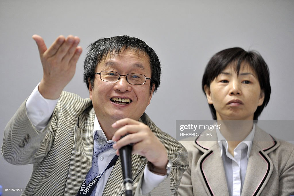 Chinese Jason Lin (L), President of Baudouin Moteurs, gestures next to Chinese Bing Bing Ren (R), the General Director, during a press conference at the plant in Cassis, southern France, on November 29, 2012. Baudouin Moteurs, engine supplier for marine, bought in 2009 by Chinese Weichai Group, signed today an agreement with French government which afford the plant to invest around one million euro (1,30 million US dollar) in training employees. AFP PHOTO/GERARD JULIEN