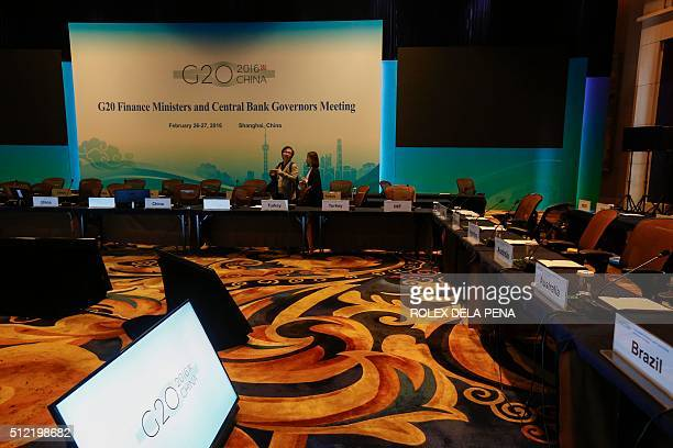 Chinese journalists view the meeting room one day before the start of the G20 Finance Ministers and Central Bank Governors Meeting in Shanghai on...