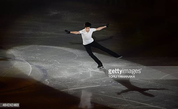 Chinese junior skater Jin Boyang performs during the gala exhibition in the ISU figure skating Grand Prix Final in Fukuoka western Japan on December...