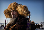Chinese Kazakh horseman watches at an eagle hunting competition on January 31 2015 in the mountains of Qinghe County Xinjiang northwestern China The...