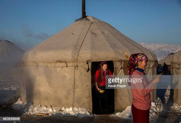 Chinese Kazakh woman stand outside a tradtional tent or Yurt at an eagle hunting competition on January 31 2015 in the mountains of Qinghe County...