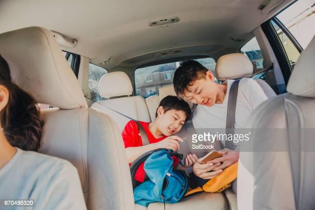 Chinese Kids Sitting in Backseat