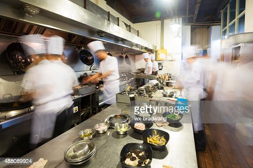 chinese kitchen busy at work stock photo. Interior Design Ideas. Home Design Ideas