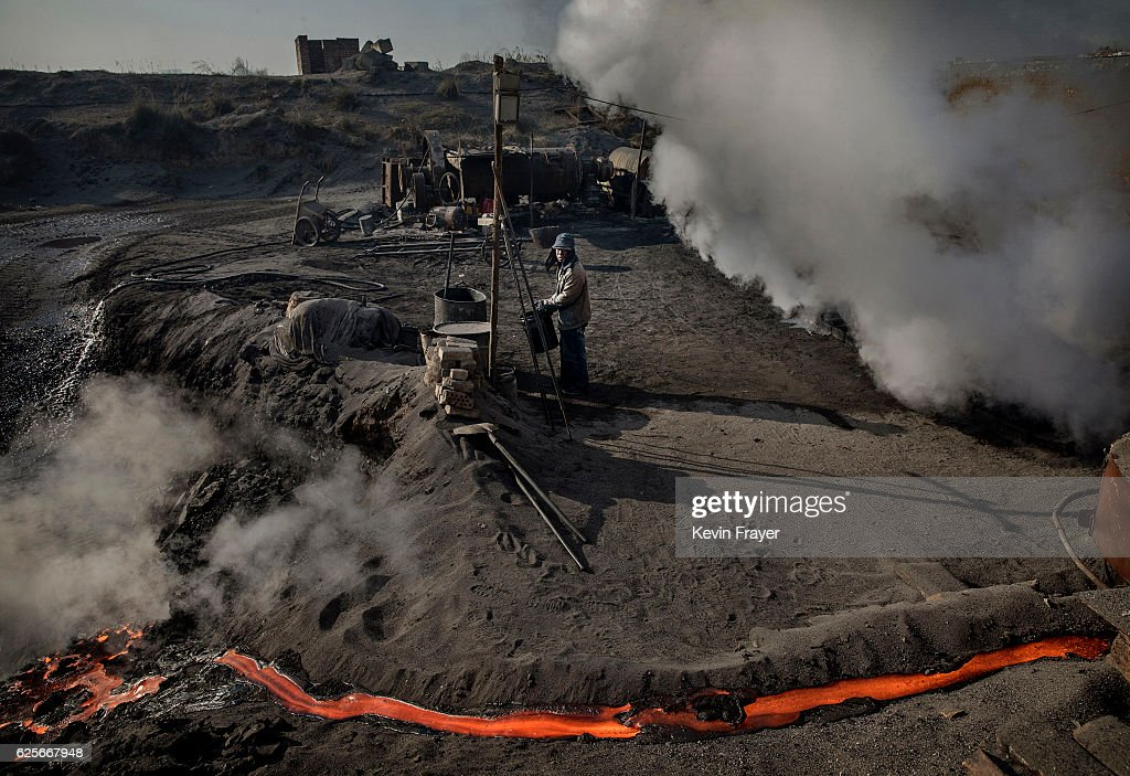 A Chinese labourer works at an unauthorized steel factory on November 3, 2016 in Inner Mongolia, China. To meet China's targets to slash emissions of carbon dioxide, authorities are pushing to shut down privately owned steel, coal, and other high-polluting factories scattered across rural areas. In many cases, factory owners say they pay informal 'fines' to local inspectors and then re-open. The enforcement comes as the future of U.S. support for the 2015 Paris Agreement is in question, leaving China poised as an unlikely leader in the international effort against climate change. U.S. president-elect Donald Trump has sent mixed signals about whether he will withdraw the U.S. from commitments to curb greenhouse gases that, according to scientists, are causing the earth's temperature to rise. Trump once declared that the concept of global warming was 'created' by China in order to hurt U.S. manufacturing. China's leadership has stated that any change in U.S. climate policy will not affect its commitment to implement the climate action plan. While the world's biggest polluter, China is also a global leader in establishing renewable energy sources such as wind and solar power.