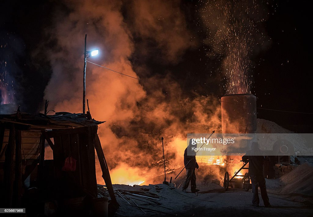 Chinese labourers work at an unauthorized steel factory on November 3, 2016 in Inner Mongolia, China. To meet China's targets to slash emissions of carbon dioxide, authorities are pushing to shut down privately owned steel, coal, and other high-polluting factories scattered across rural areas. In many cases, factory owners say they pay informal 'fines' to local inspectors and then re-open. The enforcement comes as the future of U.S. support for the 2015 Paris Agreement is in question, leaving China poised as an unlikely leader in the international effort against climate change. U.S. president-elect Donald Trump has sent mixed signals about whether he will withdraw the U.S. from commitments to curb greenhouse gases that, according to scientists, are causing the earth's temperature to rise. Trump once declared that the concept of global warming was 'created' by China in order to hurt U.S. manufacturing. China's leadership has stated that any change in U.S. climate policy will not affect its commitment to implement the climate action plan. While the world's biggest polluter, China is also a global leader in establishing renewable energy sources such as wind and solar power.