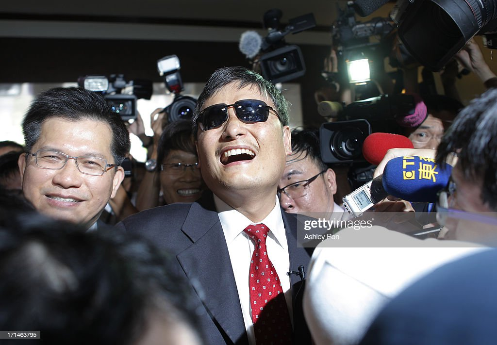 Chinese lawyer and human rights activist Chen Guangcheng arrives at the Legislative Yuan on June 25 2013 in Taipei Taiwan Chen Guangchen currently...