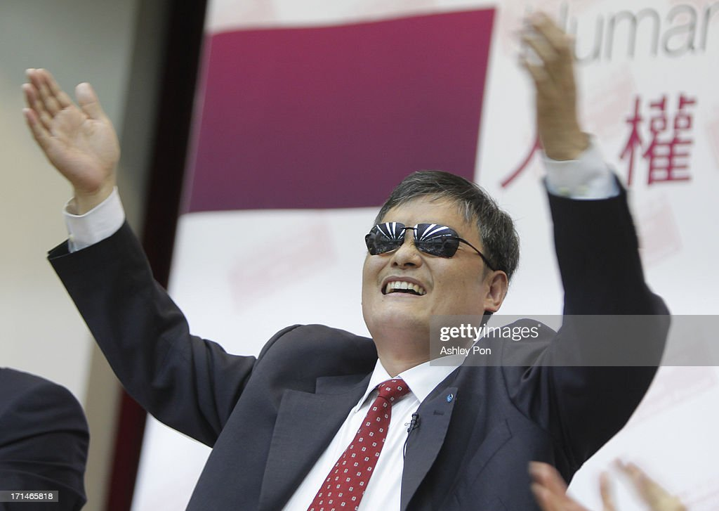 Chinese lawyer and human rights activist Chen Guangcheng gestures to the audience in the Legislative Yuan on June 25 2013 in Taipei Taiwan Chen...