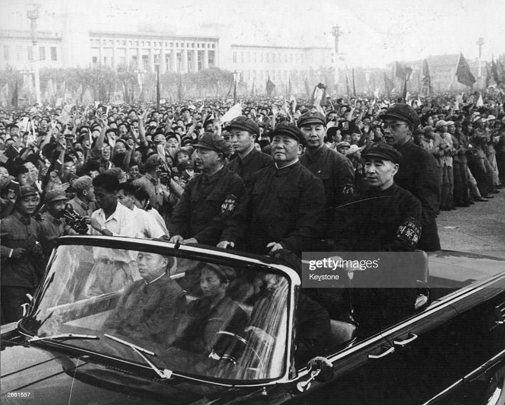 Chinese leader Mao Tsetung accompanied by his secondincommand Lin Biao passes along the ranks of revolutionaries during a rally in Tiananmen Square...