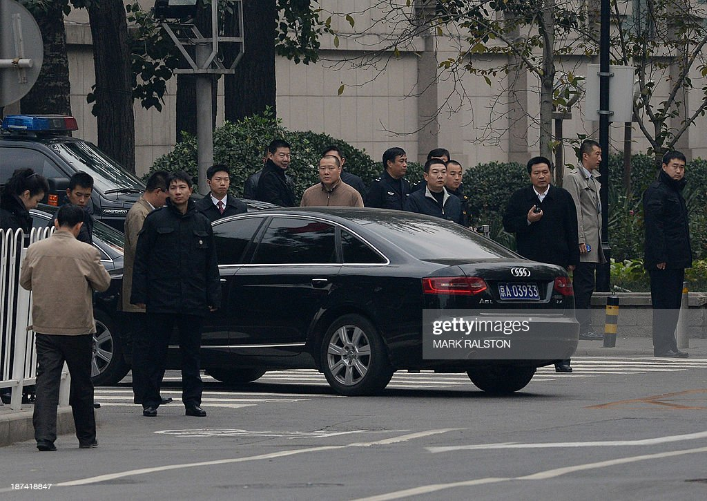 Chinese leaders and officials arrive at the Jingxi Hotel which is the site of the Communist Party Central Committee's Third Plenum in Beijing on November 9, 2013. China's ruling Party started the key meeting which is expected to focus on economic reforms a year after a closely watched leadership transition. The four-day session of the full 376-member Communist Party Central Committee takes place at a closely guarded private hotel and traditionally sets the economic tone for a new government. AFP PHOTO/Mark RALSTON