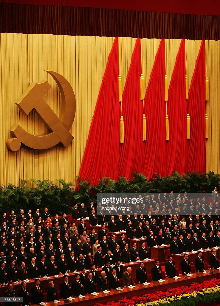 Chinese leaders attend the opening session of the five-yearly Chinese Communist Party Congress at the Great Hall of the People on October 15, 2007 in Beijing, China. The congress, which is held from October 15 to 21, will promote younger leaders and likely successors to President Hu Jintao and Premier Wen Jiabao five years hence.