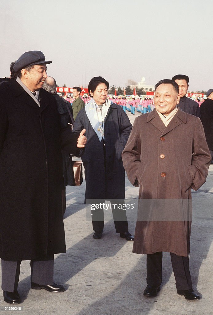 Chinese leaders Hua Guofeng and Deng Xiaoping smile in January 1978 at Beijing airport waiting for the plane of French Premier Raymond Barre prior...