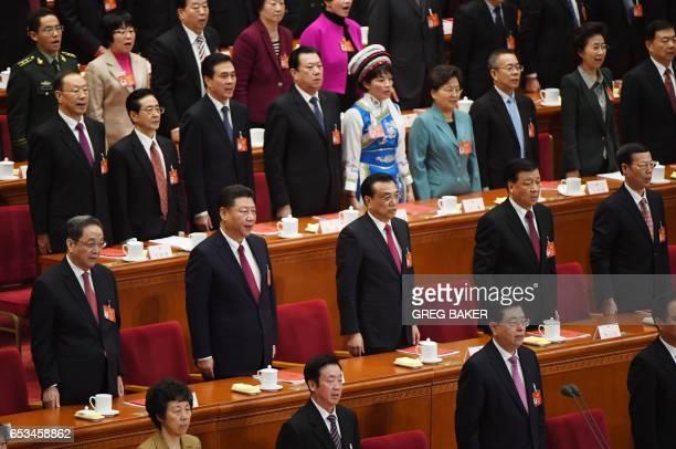 Chinese leaders including Yu Zhengsheng President Xi Jinping Premier Li Keqiang Liu Yunshan and Zhang Gaoli sing the national anthem during the...